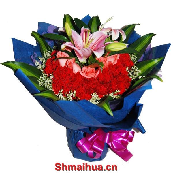 深切的问候-花束:9支粉玫瑰+29支红康乃馨+1支粉香水百合+配叶(红康乃馨在最外圈,粉玫瑰在最第二圈,粉香水百合在最里面,蓝色皱纹纸圆形包装)。
